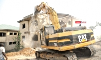 Bulldozer building demolishing
