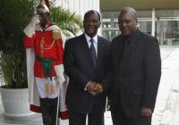 Ivorian President Alassane Ouattara (L) welcomes Ghana's President John Dramani Mahama at the presidential palace in Abidjan, September 5, 2012. REUTERS/Thierry Gouegnon