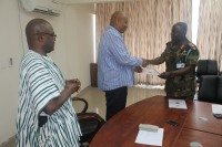 Prof. Joshua Alabi, Vice-Chancellor of UPSA and Maj. Gen. Boamah Akwa, Commandant of KAIPTC exchanging the MoU