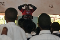 "A picture taken on  February 28, 2013 shows Conrad Njeru Karukenya, 67, aka 'Tiger-power' attempting to break in-two a six-inch nail with his bare hands during a presentation to pupils of Tenri primary school  in Kenya's central highlands county of Embu, which is also his place of birth. This living, breathing speed bump is a local legend and has a stomach that is strong enough to withstand a Land Rover running right over him, according to Discovery channel's Quest tv, hosted in the United Kingdom, which in May of last year hosted what has popularly been dubbed a 'superhuman showdown' that featured seemingly regular human beings with incredible abilities in a contest for the title of ultimate Superhuman. Divided into five unifying traits: speed, strength, endurance, brain power and skill five contestants push themselves to the limit in each episode, with Conrad placed second in the strength category, and among five finalists by internationally-acclaimed scientists Dr Heather Berlin, Dr Rahul Jandial and Professor Greg Whyte who will further select the two most impressive individuals to go head to head in the gruelling final showdown. From humble beginnings, the spiritual family man who loves eating organic food and whole grains and has never smoked or indulged in alchohol his entire life says,"" I started doing these things as a joke while in school in 1963"". AFP PHOTO /Tony KARUMBATONY KARUMBA/AFP/Getty Images"