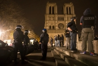 epa05023968 Armed police officers go on foot patrol around Notre-Dame cathedral and the Saint-German neighbourhood, in Paris, France, 14 November 2015. Dozens of people have been killed in a series of attacks in Paris on 13 November.  EPA/IAN LANGSDON